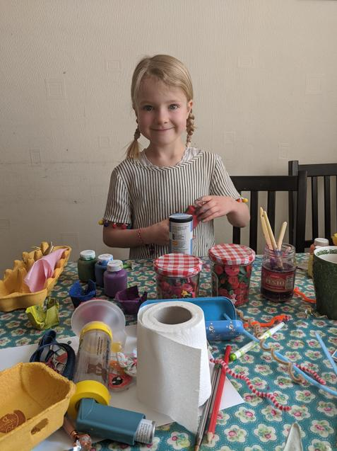 Bonnie making flowers for the elderly neighbour