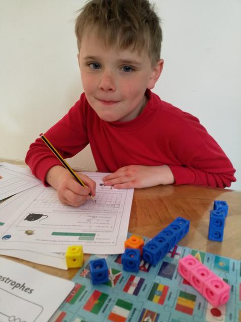 Ewan working on his maths.