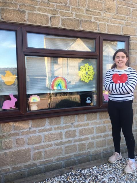 Lyla's rainbow art work in her window