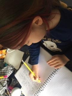 Phoebe is hard at work writing.