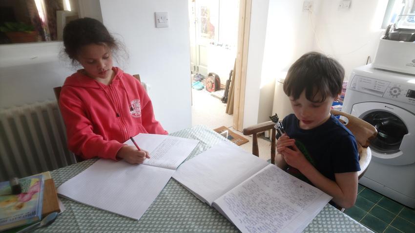 Noah and Izzy hard at work writing.