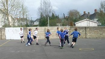 Playing tag rugby.