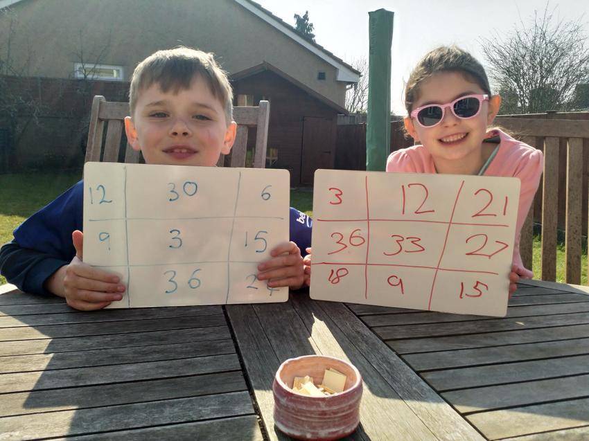 Nerys and Ewan playing times table bingo.