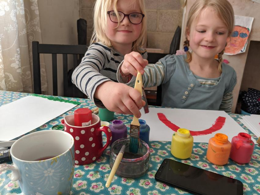 Etta and Bonnie are painting rainbows for hope