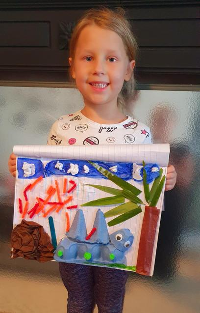 What a lovely dinosaur collage Alayah!