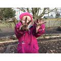 Muddy hands, happy children.