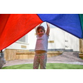 Parachute play, exploring colour size and space.