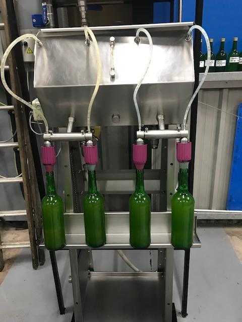 The juice is poured into bottles for drinking.