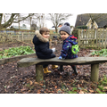Sitting with friends in Forest School