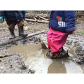 Muddy puddle jumping, building confidence.