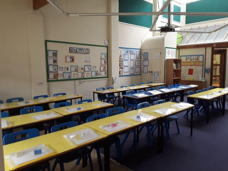 Classrooms with forward facing tables and individual resources.