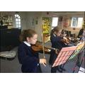 Peripatetic lessons on the violin.