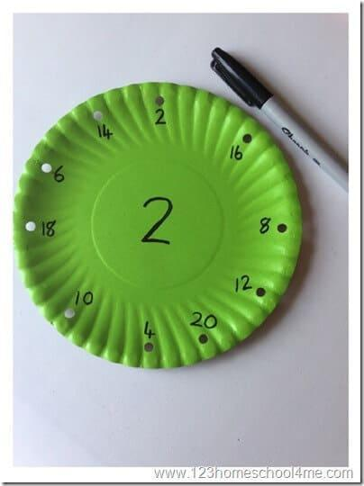 using a marker write numbers in 2s or 5s or 10s