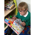 George enjoying a book in our reading corner