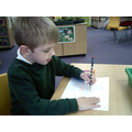 I am learning to hold a pencil and mark make