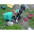 We like cookig in the mud kitchen