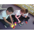 We can find a toy with 'wheels' and 'axles'