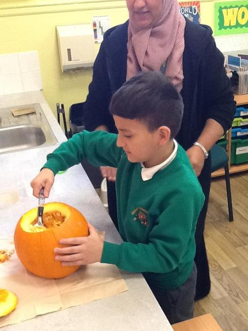Scooping out a pumpkin is great fun!
