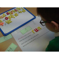 Liam made his word using magnetic letters