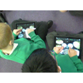 We are learning to play e-drums on the iPads