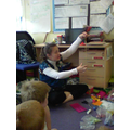 Mrs Stokes shows us how to thread a needle