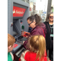 Mrs Else demonstrating a cash machine
