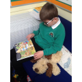 Liam enjoying a book in our book corner