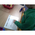 I am learning to record sums using my own mark