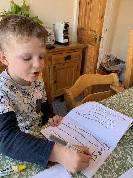 Joshua writing his weather diary