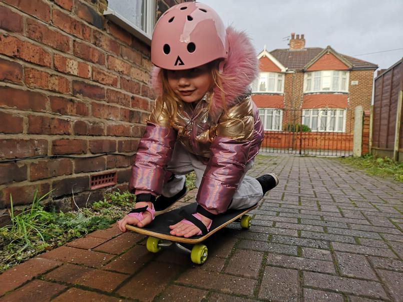 Violet practising her skateboard skills