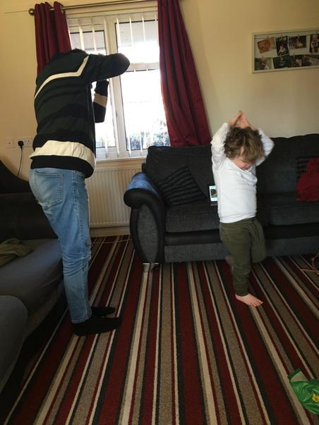Nathan & big brother doing yoga
