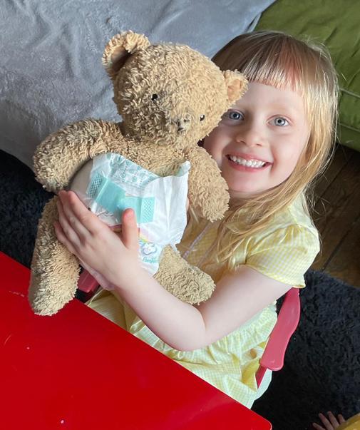 Violet looking after her baer