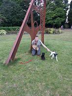 Find the sun dial sculpture in Victoria Park.