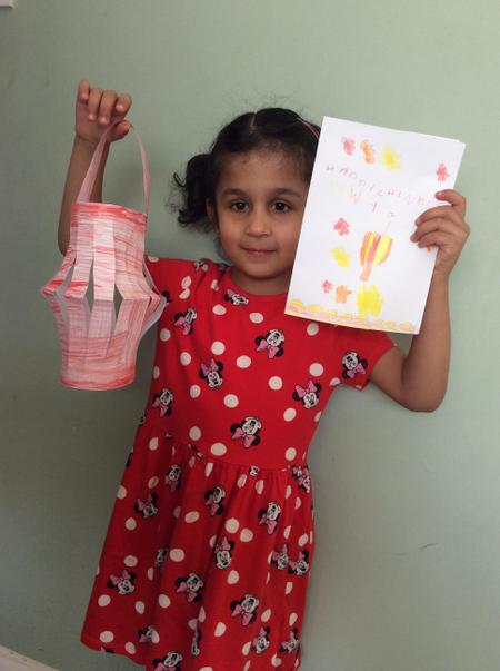 Aizah has made a Chinese lantern and new year card