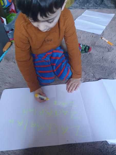 Zack writing his name