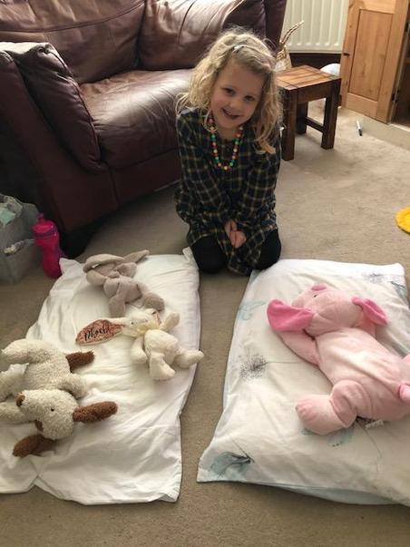 Phoebe doing the teddy maths challenge