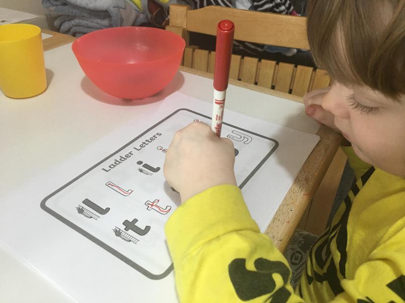 Nathan practising ladder letters