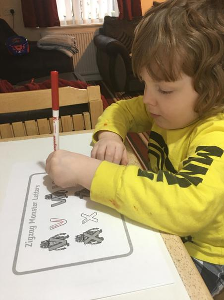 Nathan practising letter formation
