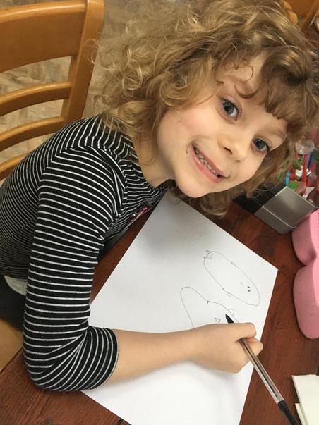Lucy drawing penguins