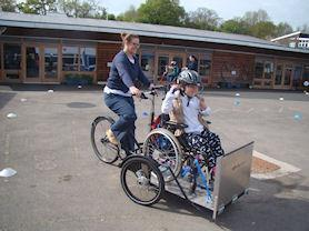 Enjoying cycling training in the playground.