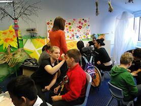 Face painting with local college students.