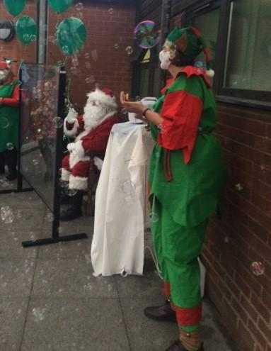 Father Christmas was accompanied by his elves.