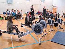 Indoor rowing at a sporting event in the city.