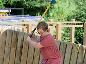Practising a golf swing.