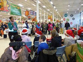 School choir performing at Sainsbury's.