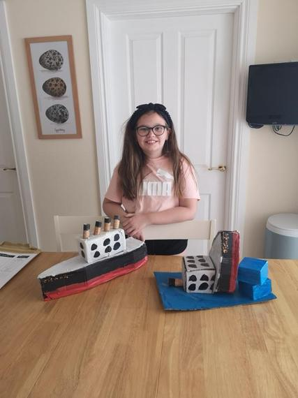 Rosie with a complete Titanic and a sinking Titanic