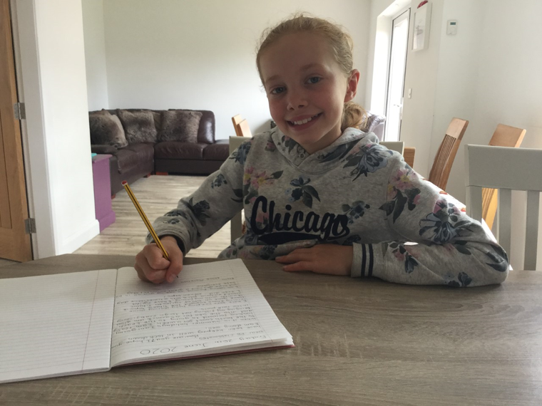 Chloe writing her letter