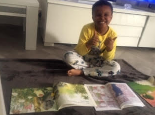 Kirubel pleased with his books on Pyjamarama Day!