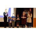 Vittoria receives their prize.