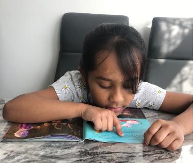 Anaya enjoying her Frozen book on Pyjamarama Day!